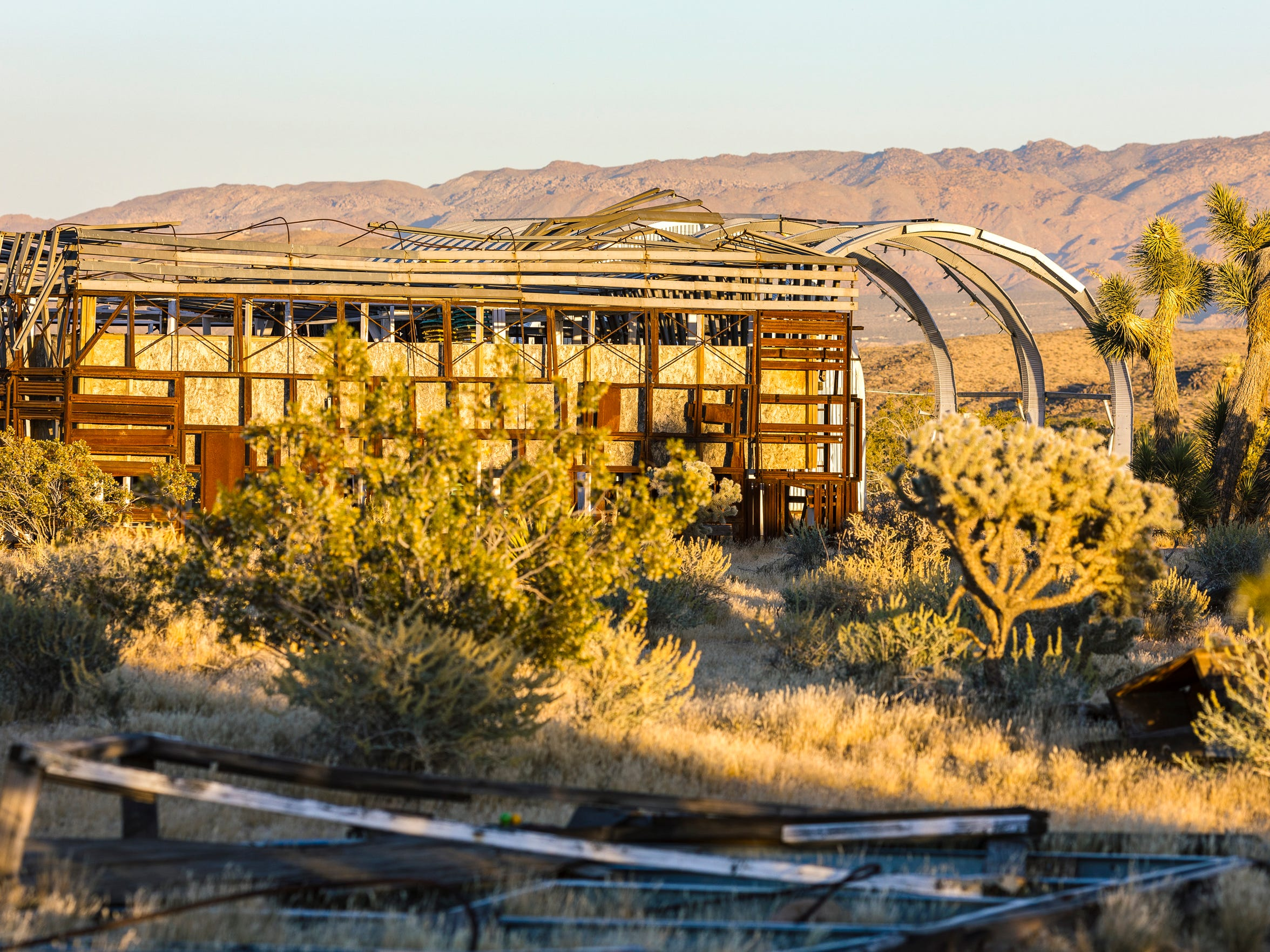 """Noah Purifoy's """"Quonset Hut"""" can be seen peeking out from behind his """"Adrian's Little Theater."""""""