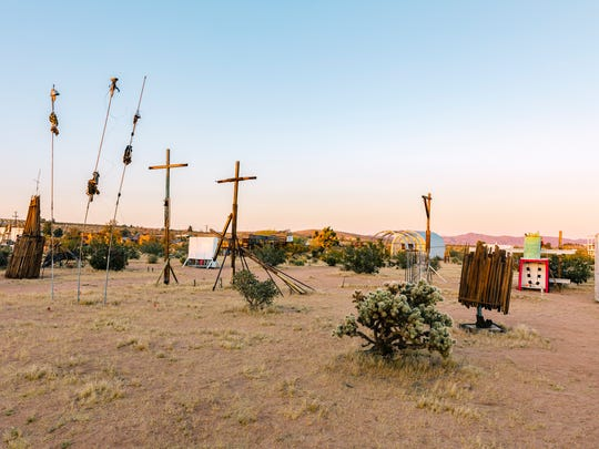 "Noah Purifoy's ""Three Witches"" can be seen at left."
