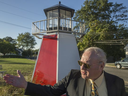 Edward D. Balyk, Keansburg Historical Society president, in front of a replica lighthouse unveiled last year.