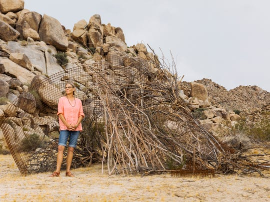 "Copper Mountain College fine arts professor and artist Cathy Allen beside her ""Dwelling No. 62"" at BoxoHOUSE in Joshua Tree"
