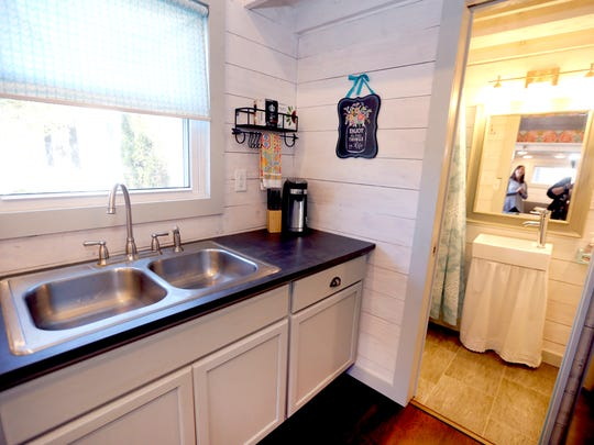The kitchen that leads to the bathroom of the Pearson's  tiny house on Tuesday, Oct. 31, 2017.