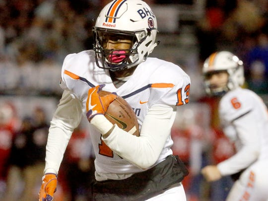 Blackman's Trey Knox (13) runs the ball during the second round of the play-off game against Oakland on Friday, Nov. 10, 2017, at Oakland.