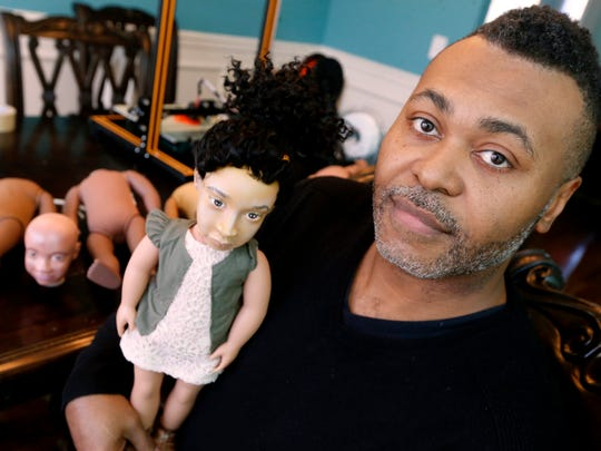 Micah Otis hold the first ever Minnie Me doll made