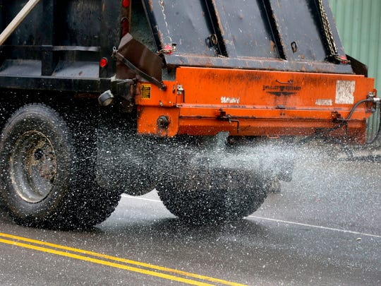 A salt truck from the Murfreesboro City Streets Division covers a section of Park Place in Murfreesboro with salt on Friday, Jan. 12, 2018.