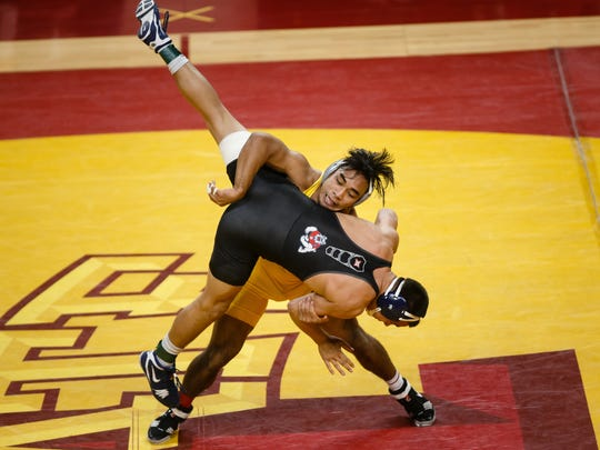 Iowa State's Dane Pestano throws Fresno State's Angel Solis during their 184 lb match on Friday, Feb. 9, 2018, in Ames. Pestano pinned Solis and Iowa State would go on to win the dual 26-22.