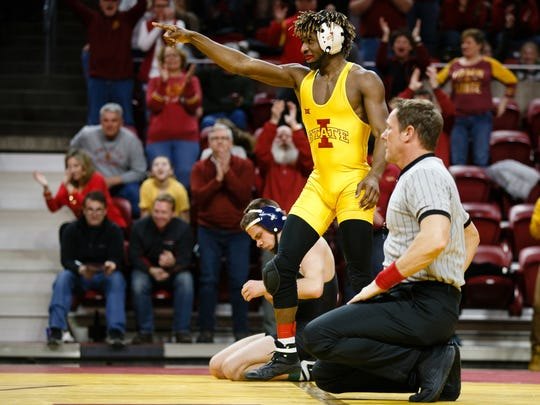Iowa State's Markus Simmons reacts after pinning Fresno State's Trevor Williams during their 133lb match on Friday, Feb. 9, 2018, in Ames. Iowa State would go on to win the dual 26-22.