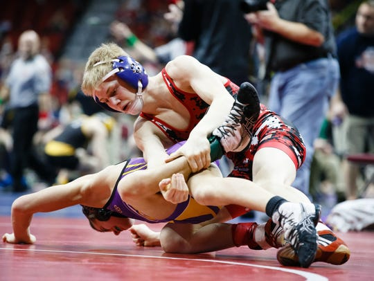 Matthew Lewis of Centerville, top, wrestles Keaton Zeimet of Central Dewitt during their first round 2A 106-pound match on Thursday, Feb. 15, 2018, in Des Moines. Lewis won the match with a 15-1 major decision.