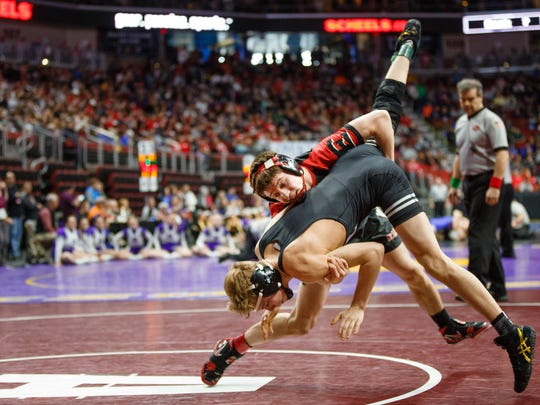 Brock Espalin of Des Moines East wrestles Cody Anderson of Waukee during their first round 3A state championship 120 lb match on Thursday, Feb. 15, 2018, in Des Moines. Espalin went on to win 5-2.