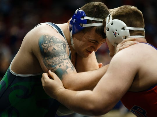 Cameron Beminio of Belmond-Klemme wrestles Brian Sadler of Jessup during their 285 lb 1A semi-final round at the state wrestling championships on Friday, Feb. 16, 2018, in Des Moines.
