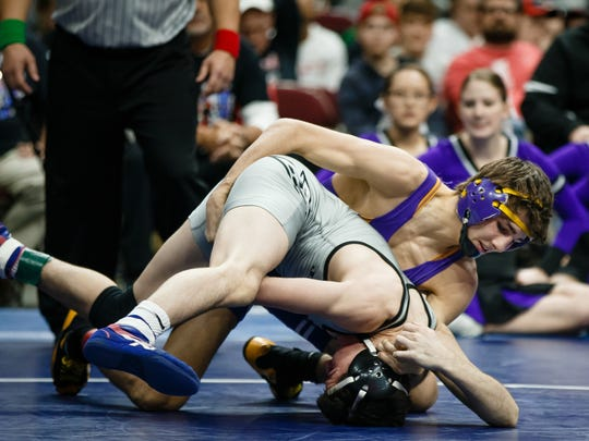 Waukee's Kyle Biscoglia wrestles Ankeny Centennial's Ben Monroe during their class 3A 120 pound championship match at Wells Fargo Arena on Saturday, Feb. 17, 2018, in Des Moines. Biscoglia would go on to win 9-2.