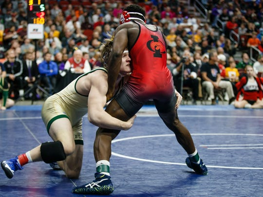 Nelson Brands of Iowa City, West wrestles Iowa City, City HighÕs Wilfred Kadohou during their class 3A 160 pound championship match Wells Fargo Arena on Saturday, Feb. 17, 2018, in Des Moines. Steffensmeier would go on to win 5-4. Brands would go on to win 22-7.