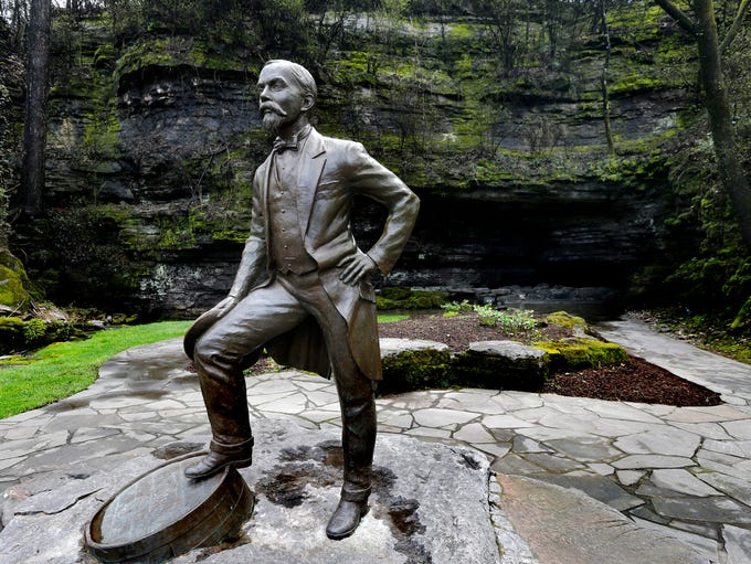 "A statue entitled ""Jack on the Rocks"" is in front of"