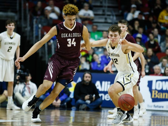 Oskaloosa's Xavier Foster (34) goes after a ball after having it stripped by Glenwood's Andrew Blum (12) during the first half of their 3A state basketball championship game on Friday, March 9, 2018, in Des Moines.