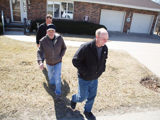 Mickey Anderson, back, Steve Bruning, center, and Tim Johnson, front, walk away from the first spec home the Industrial foundation built in Stanton, Iowa years ago. The town has a population of 600, most of which leave for work every morning. The tiny town has staved off the decline a lot of of small towns face as population declines but local residents have been building and renovating homes that attract young families wanting to live outside the big city. Here the downtown is seen on Wednesday, March 14, 2018.