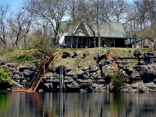 The home shown on the 55-acre site off Asbury Road that Sazerac of Tennessee hopes to purchase would be replaced by a testing facility for vendors and MTSU fermentation science students. Sazerac distiller Allisa Henley said the limestone surrounding the lake helps remove iron and other heavy metals from the water.
