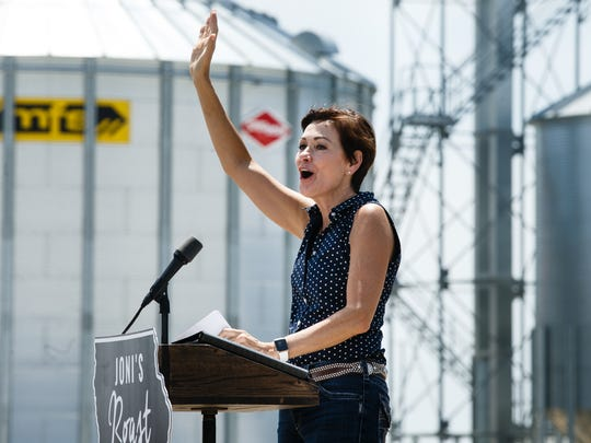Iowa Governor Kim Reynolds speaks during the fourth annual Roast and Ride from Big Barn Harley Davidson in Des Moines to the Central Iowa Expo on Saturday, June 9, 2018, in Boone.
