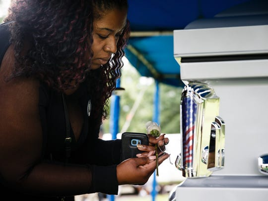 Toccora Baker, 35, of Cedar Rapids, holds the ID tags of her great-uncle Sgt. Donald Baker after he was laid to rest on Tuesday, June 19, 2018, in Cedar Rapids. Donald Baker died while serving in the Korean War and his remains were not identified and returned to the family until recently.