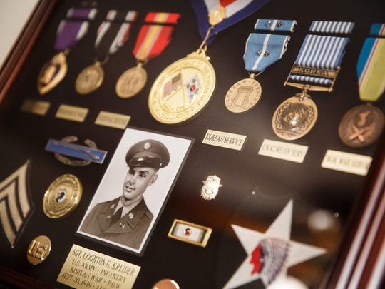 A plaque and shadowbox of medals in honor of Leighton Kreider hangs in the home of his brother Harlan on Tuesday, June 26, 2018. Leighton died while serving during the Korean War in 1951. His remains have yet to be identified and his younger brother Harlan has spent his whole life trying to bring is brother home.