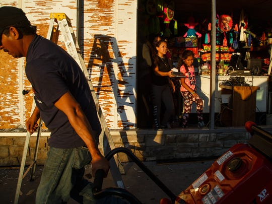The Vargas family clean up their store, Abarrotes la