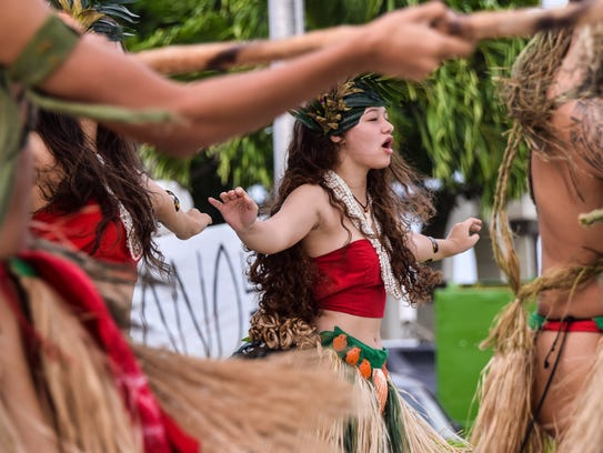 Inetnon Gefpå'go cultural dancers perform during the