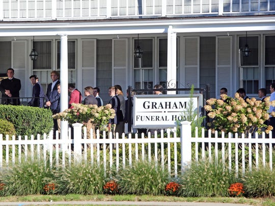 Mourners arrive for the wake of Manhattanville College student Robby Schartner at Graham Funeral Home in Rye, Oct. 11, 2016. Schartner, 21, was struck and killed early Sunday as he walked along Westchester Avenue.