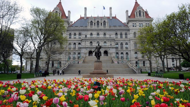 Exterior view of the New York state Capitol and blooming tulip garden on Monday, May 8, 2017, in Albany, N.Y.