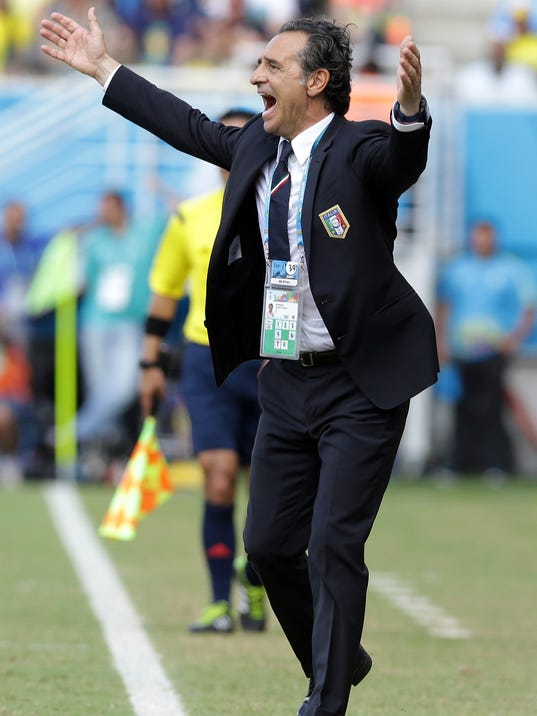 Italy's head coach Cesare Prandelli gestures during the group D World Cup soccer match between Italy and Uruguay at the Arena das Dunas in Natal, Brazil, Tuesday, June 24, 2014. (AP Photo/Antonio Calanni)