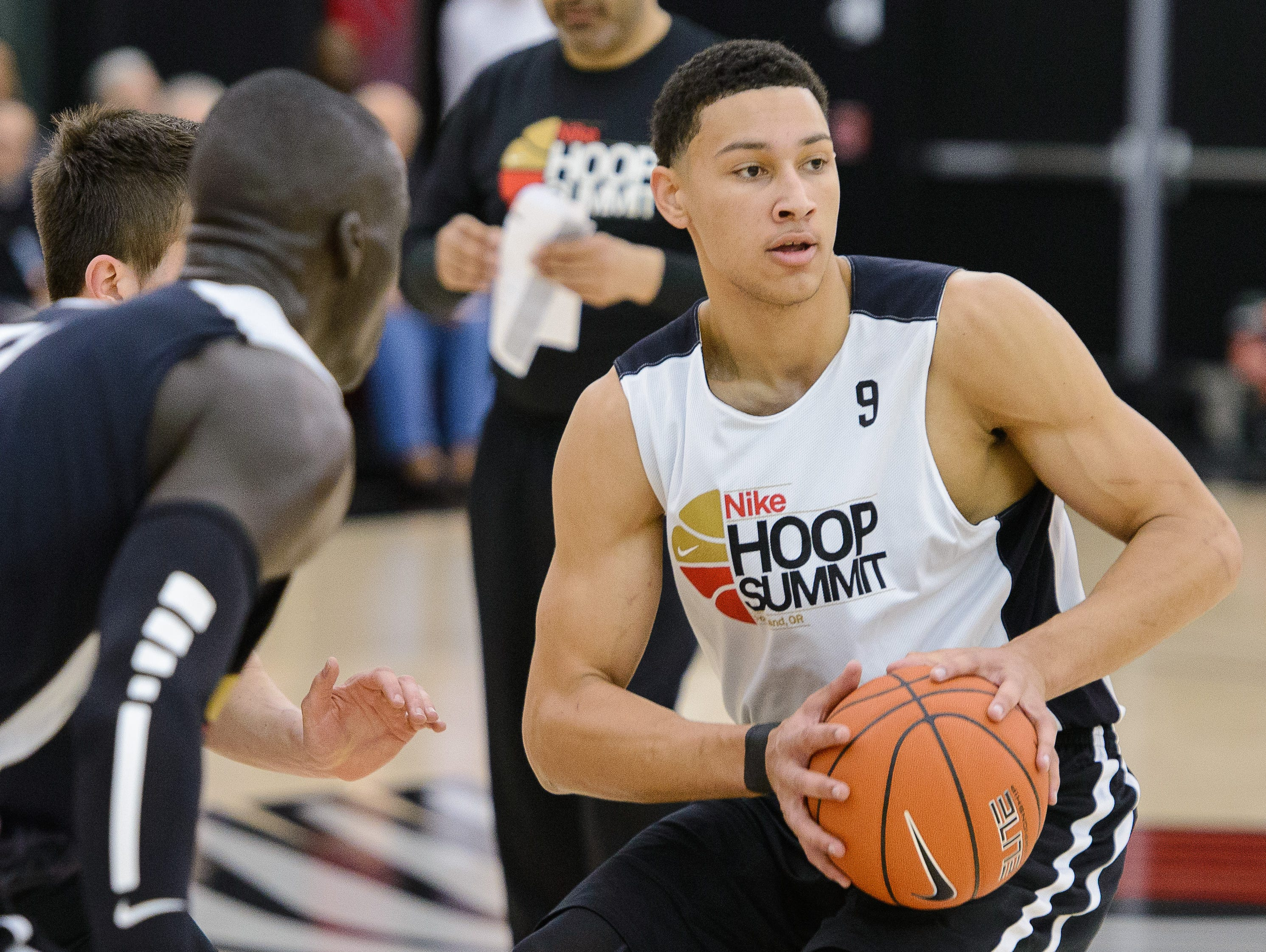 Ben Simmons looks to pass in a World Team practice.