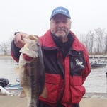 Robbie Bridges holds a 7.24-pound bass that took the lunker category in Sunday's Sunset Marina at 43 tournament.