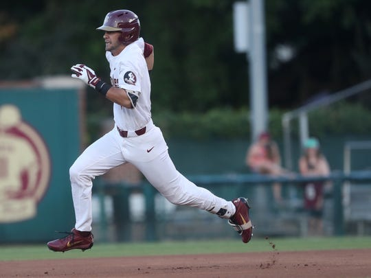 FSU's Steven Wells Jr. rounds first base against Samford during their NCAA Regional game at Dick Howser Stadium in Tallahassee, Fla. On Friday, June 1, 2018.