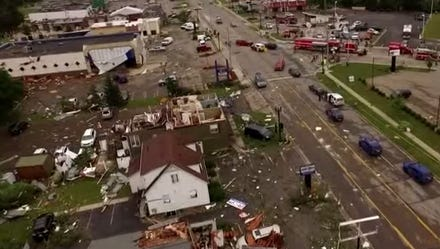 Clean-up efforts continued in earnest around Portland Tuesday as crews worked to remove debris left from Monday's tornado.