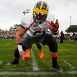 Michigan offensive lineman Graham Glasgow runs through drills during practice for the Senior Bowl on Jan. 26, 2016, at Fairhope Municipal Stadium, in Fairhope, Ala.