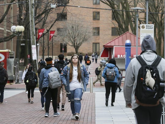 Temple senior Francesca Furey walks to her last face-to-face class at Temple. Class started at 5:30pm, Thursday, March 12, 2020. (Steven M. Falk/The Philadelphia Inquirer/tNS)