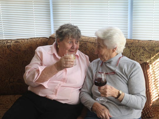Jan Moore and Emily Sonnessa of Ocean Grove have been together for 45 years. They are sharing their traditional 4 p.m. cocktail before dinner.