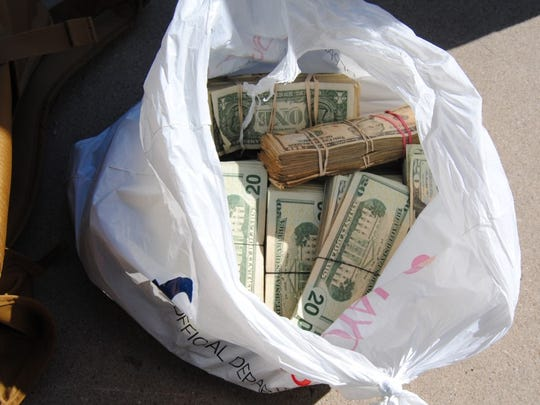 The South Texas Specialized Crimes and Narcotics Task Force seized shopping bags, backpacks and duffle bags filled with $427,481 in cash on April 10, 2018.
