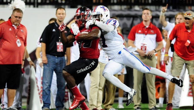Western Kentucky Hilltoppers running back Leon Allen (33) is stopped by Louisiana Tech Bulldogs safety Xavier Woods (7) down the field during the first half at Houchens Industries-L.T. Smith Stadium.