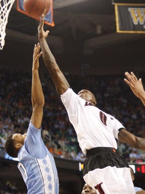 U of L's Terry Rozier led the Cards with 13 points in the first half Thursday.