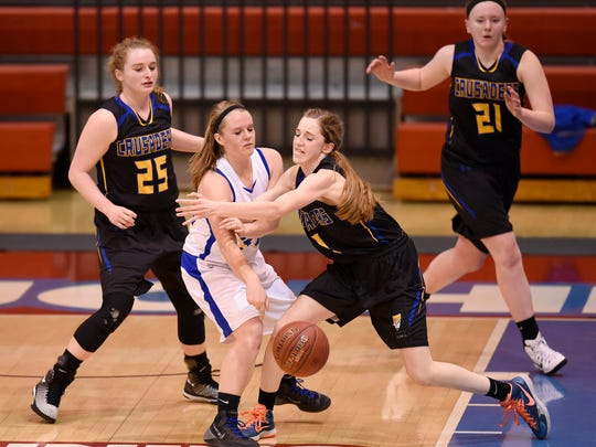 Cathedral players try to get control of the ball during the first half of Tuesday's East Sub-Section 6-2A playoff game against Rush City at St. John's University in Collegeville.