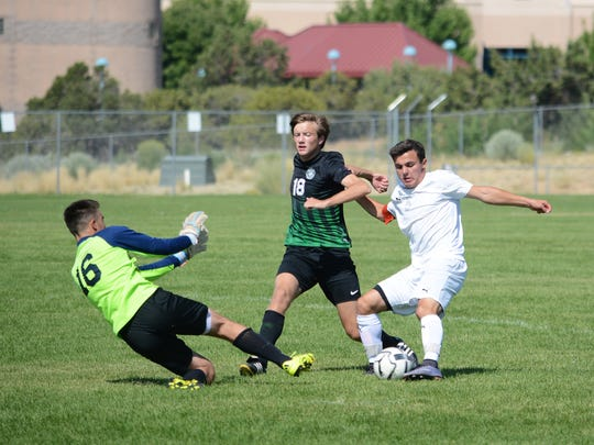 Piedra Vista's Max Eisenfeld takes a quick shot with his left foot deep into Hope Christian's goalkeeper box during the first half Saturday's match at PVHS.