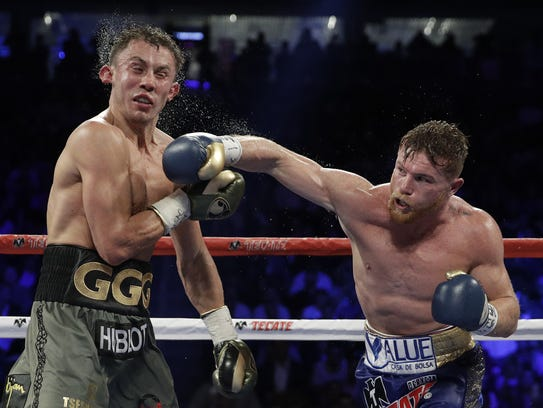 Canelo Alvarez, right, connects with a right to Gennady