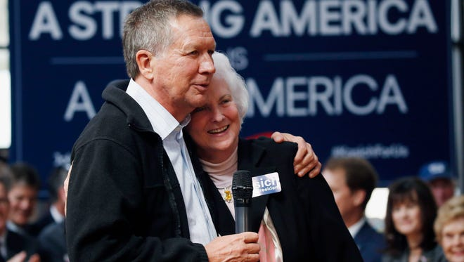 Republican presidential candidate Gov. John Kasich of Ohio hugs Barbara Hudson, wife of State Sen. Billy Hudson, R-Hattiesburg, who with her husband endorsed Kasich during a town hall meeting in Gulfport, Miss., Wednesday, Feb. 24, 2016.
