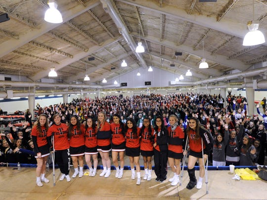 The Iraan High School cheerleaders gather for a group picture with the hundreds of other West Texas cheerleaders that came to support them Friday Dec. 9, 2016 in Abilene. The squad's sponsor Elizabeth Pope died in a car accident a week earlier as they were returning from a game. All the cheerleader gathered at the Taylor County Expo Center for a meal, then crossed the street to Shotwell Stadium for the playoff game.