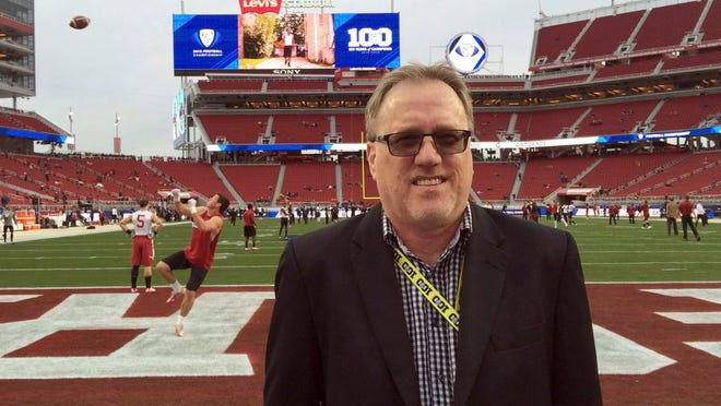 From Dec. 5, 2015, Los Angeles Times sportswriter, Chris Dufresne poses near the end zone before the Pac-12 championship NCAA college football game in Santa Clara, Calif. Dufresne, an award-winning former sports writer for the Los Angeles Times, died suddenly Monday while dining with his family at home in Chino Hills, 30 miles east of Los Angeles, according to a Times staff memo posted Tuesday, May 26, 2020, on Facebook. He was 62.
