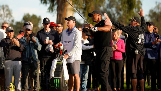 Tiger Woods hits out of the rough on the 18th hole during the first round of the Genesis Invitational golf tournament at Riviera Country Club, Thursday, Feb. 13, 2020, in the Pacific Palisades area of Los Angeles.