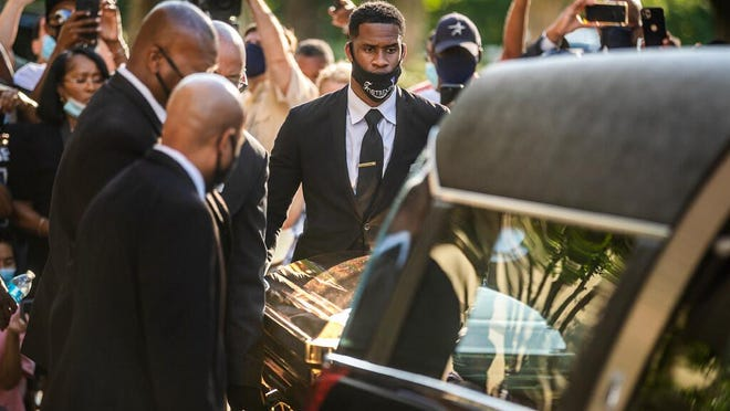 The casket of George Floyd is placed into a hearse at Fountain of Praise church in Houston, Monday, June 8, 2020. Floyd died May 25 after being restrained by police in Minneapolis.