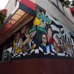The heritage and history of the Belmont and Devilliers district is reflected in the murals painting on its walls.