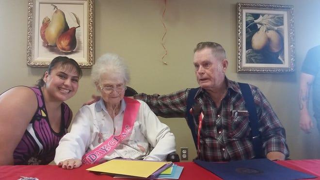 Marisa Marshall, from left, Nelda Marshall, and Everrett Marshall celebrate during Nelda Marshall's 100th birthday celebration.