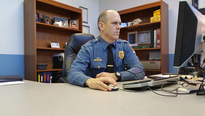 Newly appointed Millsboro Police Chief Brian Calloway sits at his desk at the Millsboro Police Department on Wednesday, Jan. 14.