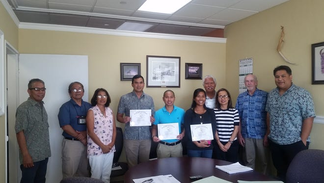The Guam Board of Registration for Professional Engineers, Architects & Land Surveyors congratulates the New Professional Engineers and Professional Land Surveyor who has successfully completed the NCEES Engineering and Surveying Exam on April 15. Board members from Left: Philip I. Villanueva, Public Member; Paul L. Santos, PLS, Member; Liza J. Provido, RA AIA, Member; Joseph V. Illagan, PE; Paul R.C. Audije, PE; Jecelia A.L. Llegado, PE; Gavino Aquilar Estur, PLS (Back Row); Maria Elisabeth V. Cristi, PE, Sec.& Tres.; H. Mark Ruth, RA FAIA, Vice Chair; Gabriel Jugo, PE, SE, Chairman
