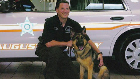 Ren poses with her former handler, Jesse Bryant.